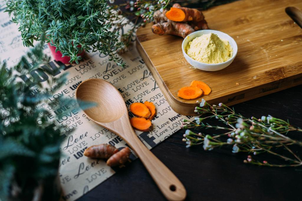 green herbs, turmeric and vegetables