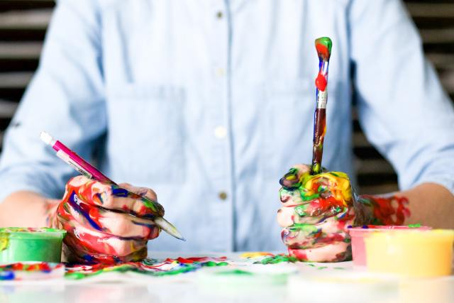 man drawing with paintbrush
